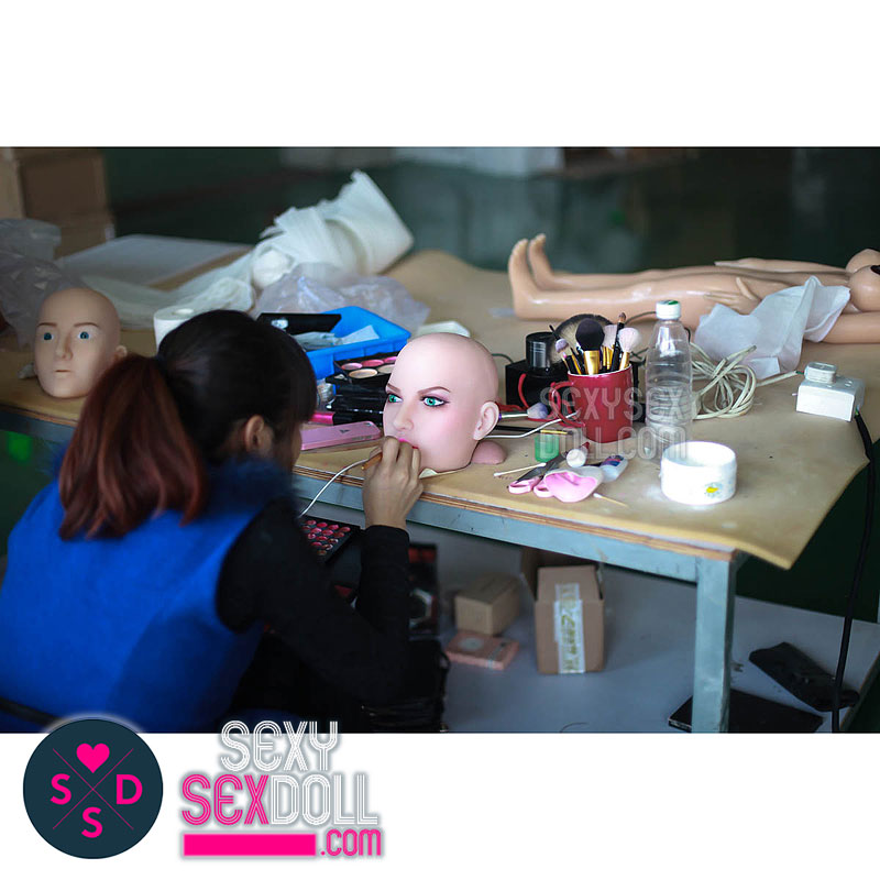 sex doll factory-Professional Makeup Artist Working on The Doll